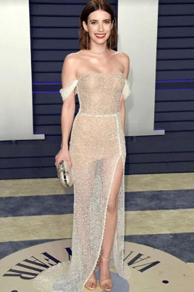 I predict that by Emma Roberts pairing the Yanina Couture gown with the pearl-embellished sheer minimalist makeup, she has now inspired brides everywhere for this look.