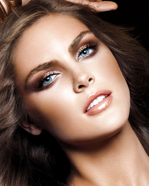 Hilary Rhoda, full brows frame her piercing blue eyes